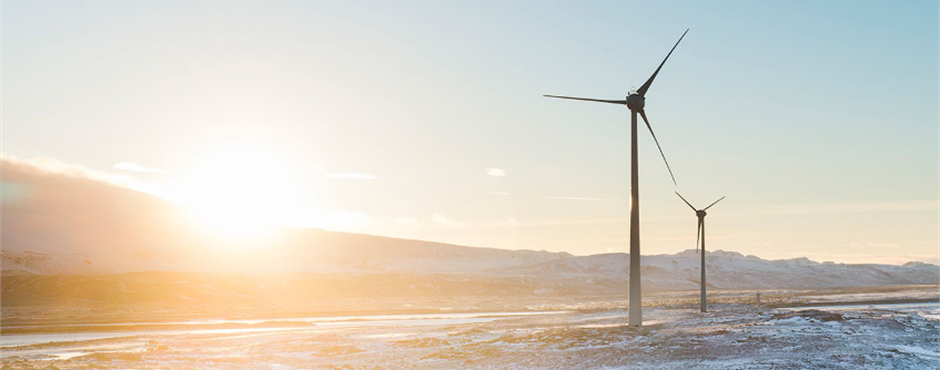 Wind turbines in a cold climate surrounded by ice